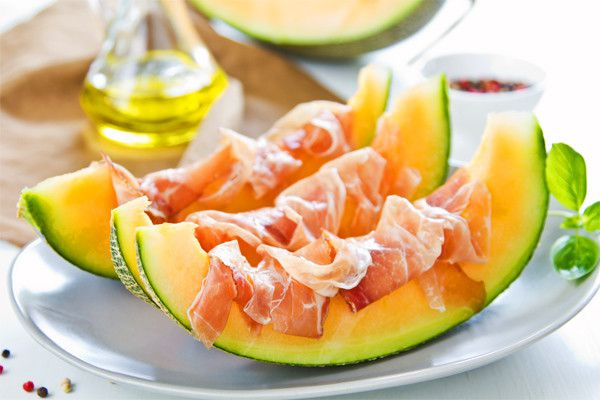 Appetizer of melon and prosciutto