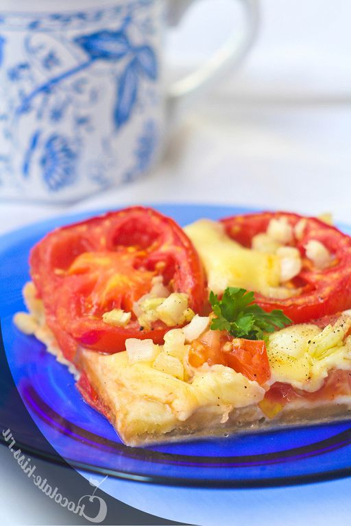Open pie with tomatoes and mozzarella
