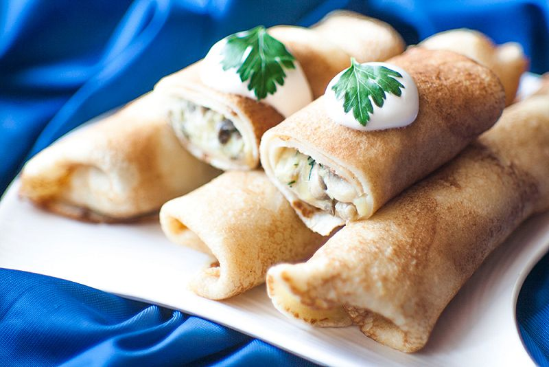 Pancakes stuffed with potatoes and mushrooms