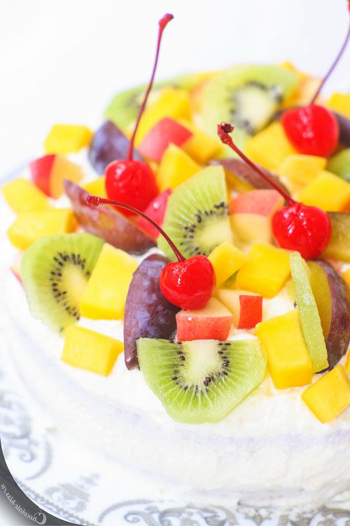 Angelic cake with fruit and a creamy cream