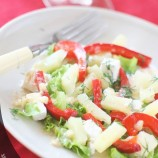 Salad with chicken, feta cheese and roasted peppers