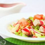 Salad with chicken and cranberry sauce