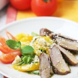 Salad with duck breast, pepper and cheese